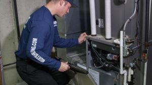 technician working on furnace